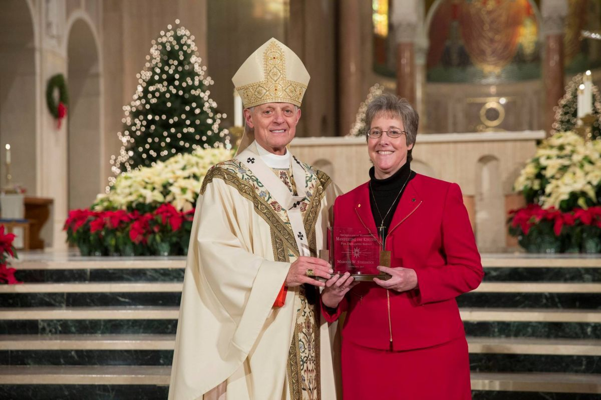 "Ms. Strishock receives the ""Manifesting the Kingdom Award"" from Cardinal Wuerl in January 2017."